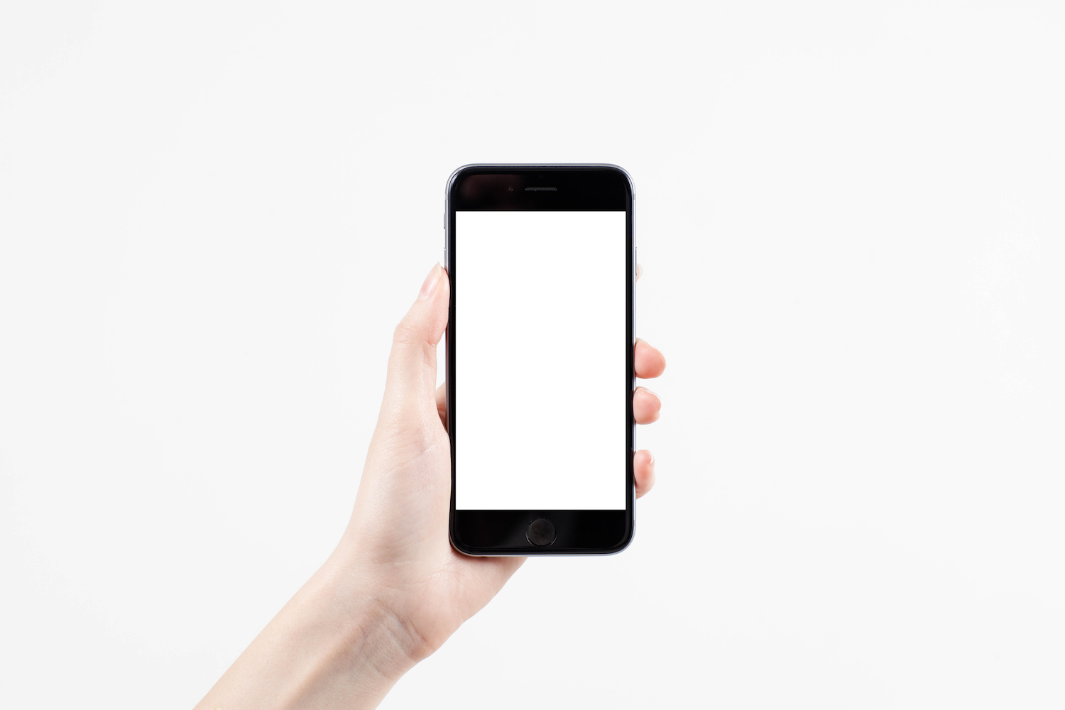 Hand holding mobile smart phone with blank screen on white background example image 1