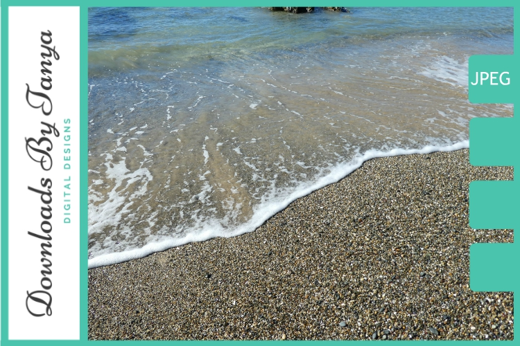 Waves lapping a pebble beach photo example image 1