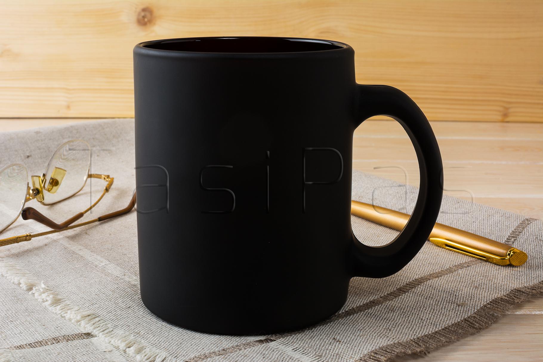 Black coffee mug mockup with glasses and pen example image 2
