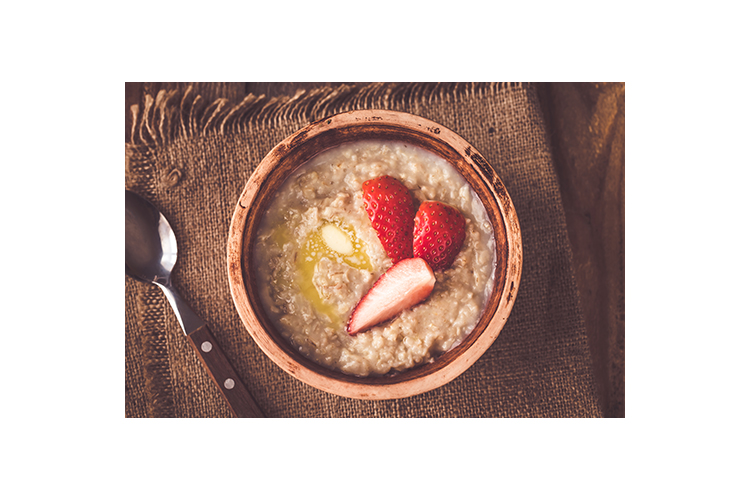 Bowl of oats with fresh strawberries example image 1