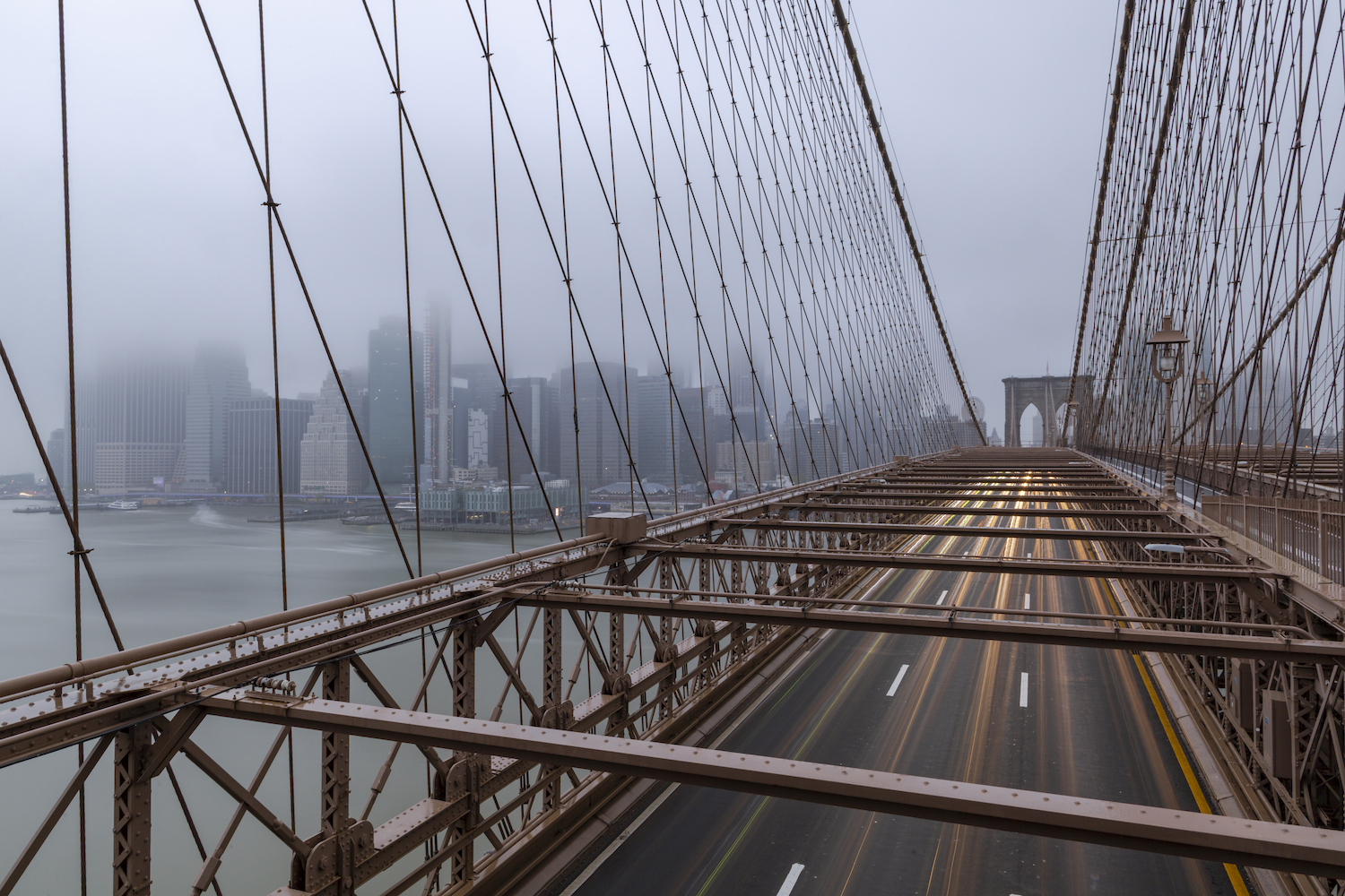 View from Brooklyn bridge on a driveway and finance district example image 1