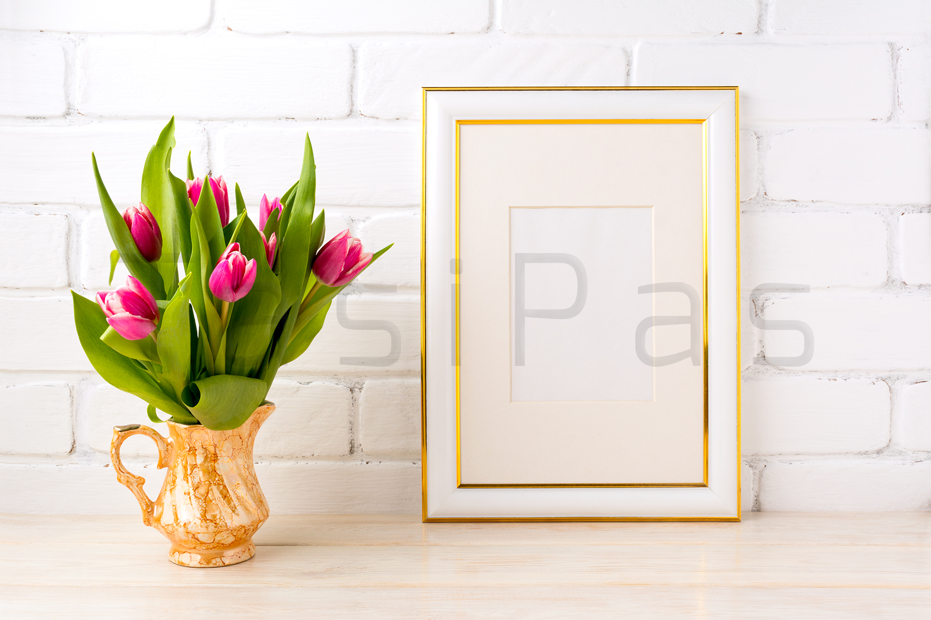 Gold decorated frame mockup with bright pink tulips bouquet in gold jug near white painted brick wall.  example image 3
