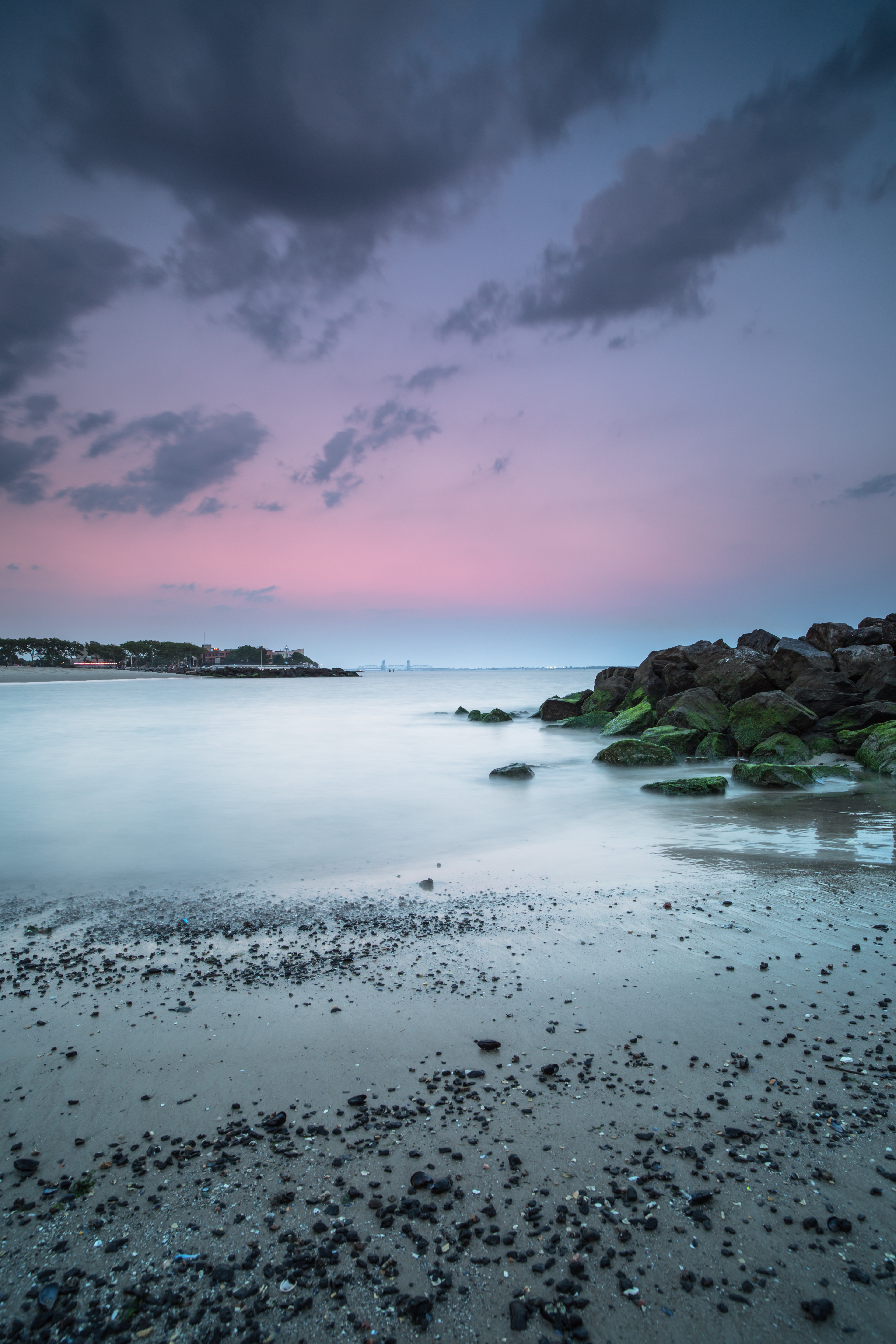 Sunset on the beach with rocks and mussels example image 1