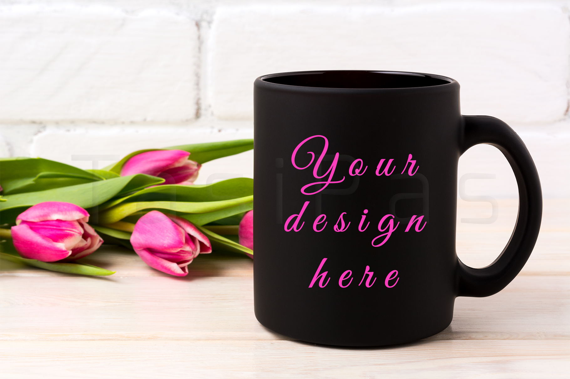 Black coffee mug mockup with rich magenta pink tulips bouquet near painted brick wall. example image 1