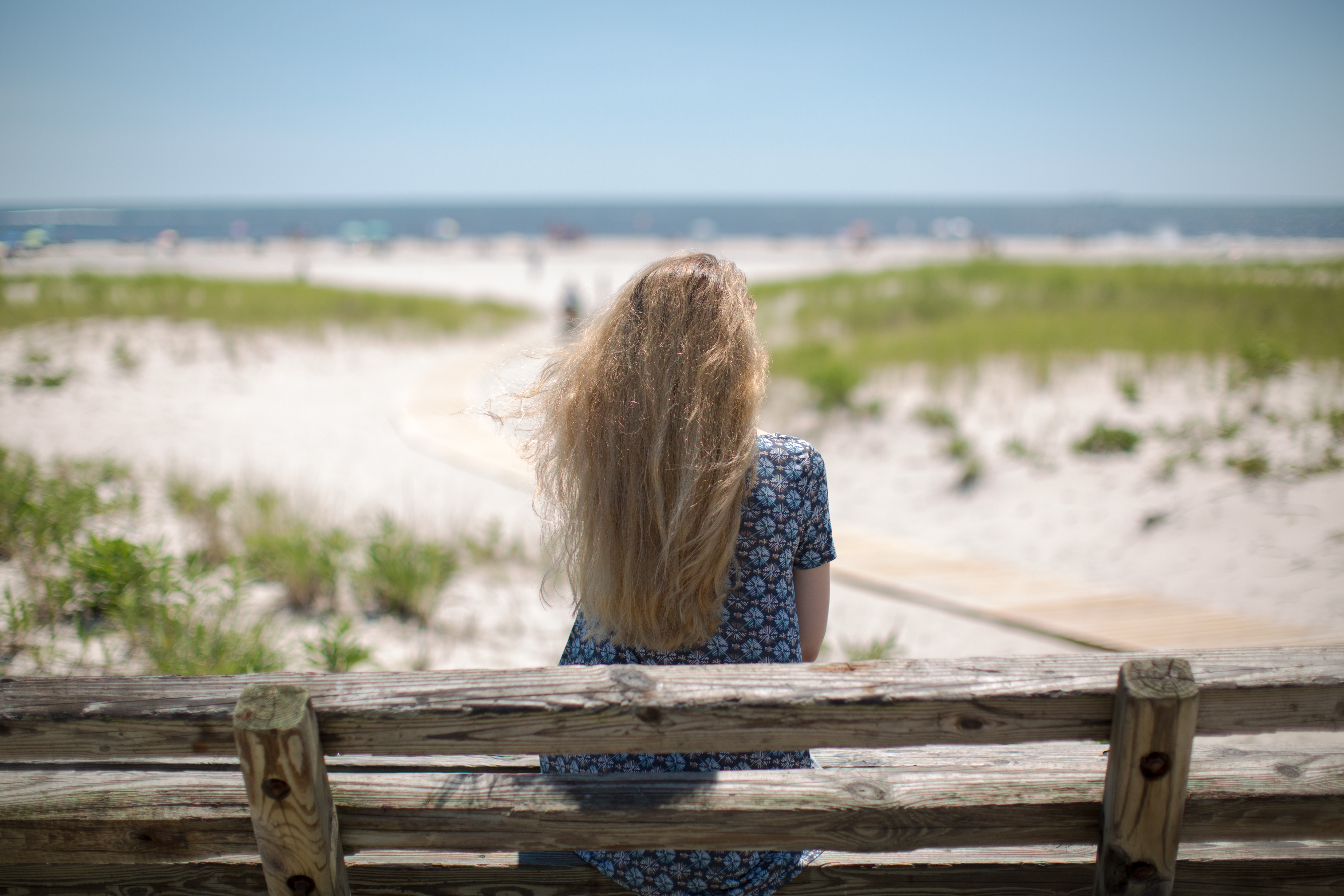 Women sitting on the bench at the ocean example image 1
