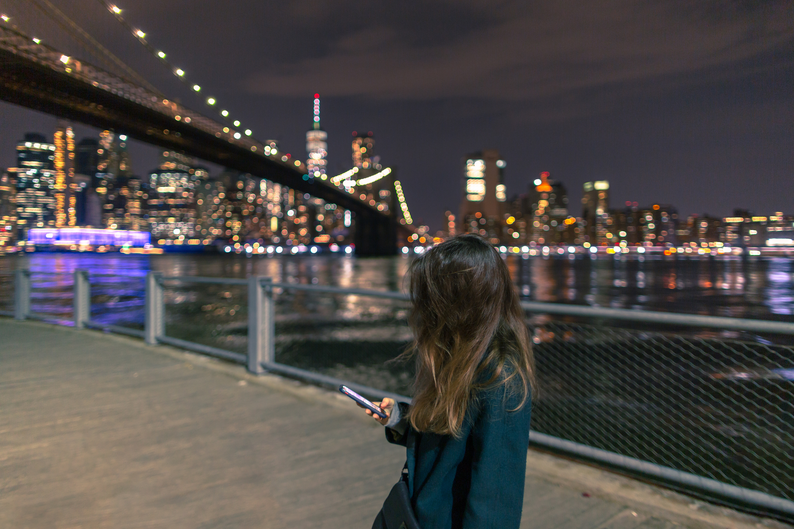 Women on the smartphone in New York at night example image 1