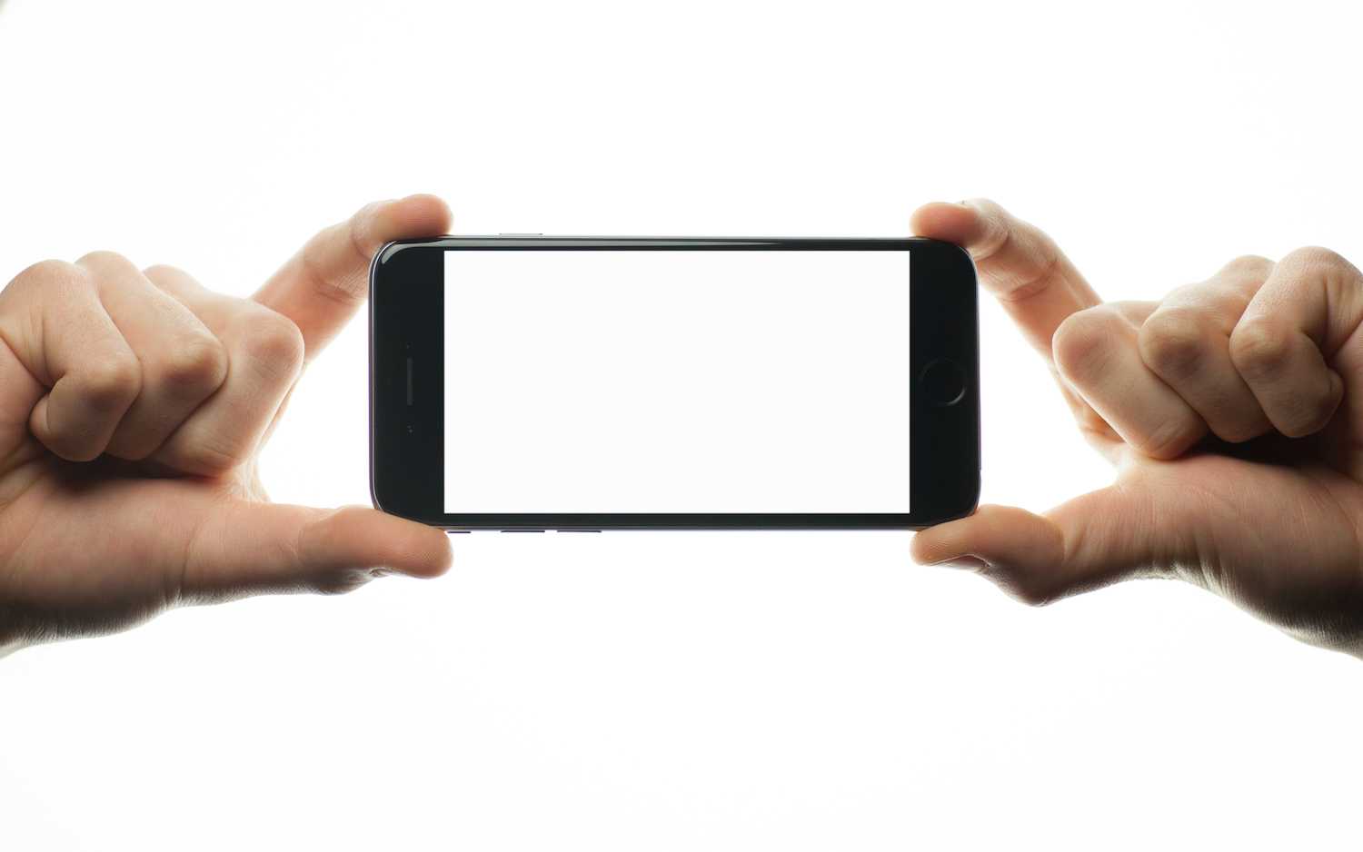 Two hands holding smartphone with blank screen  example image 1
