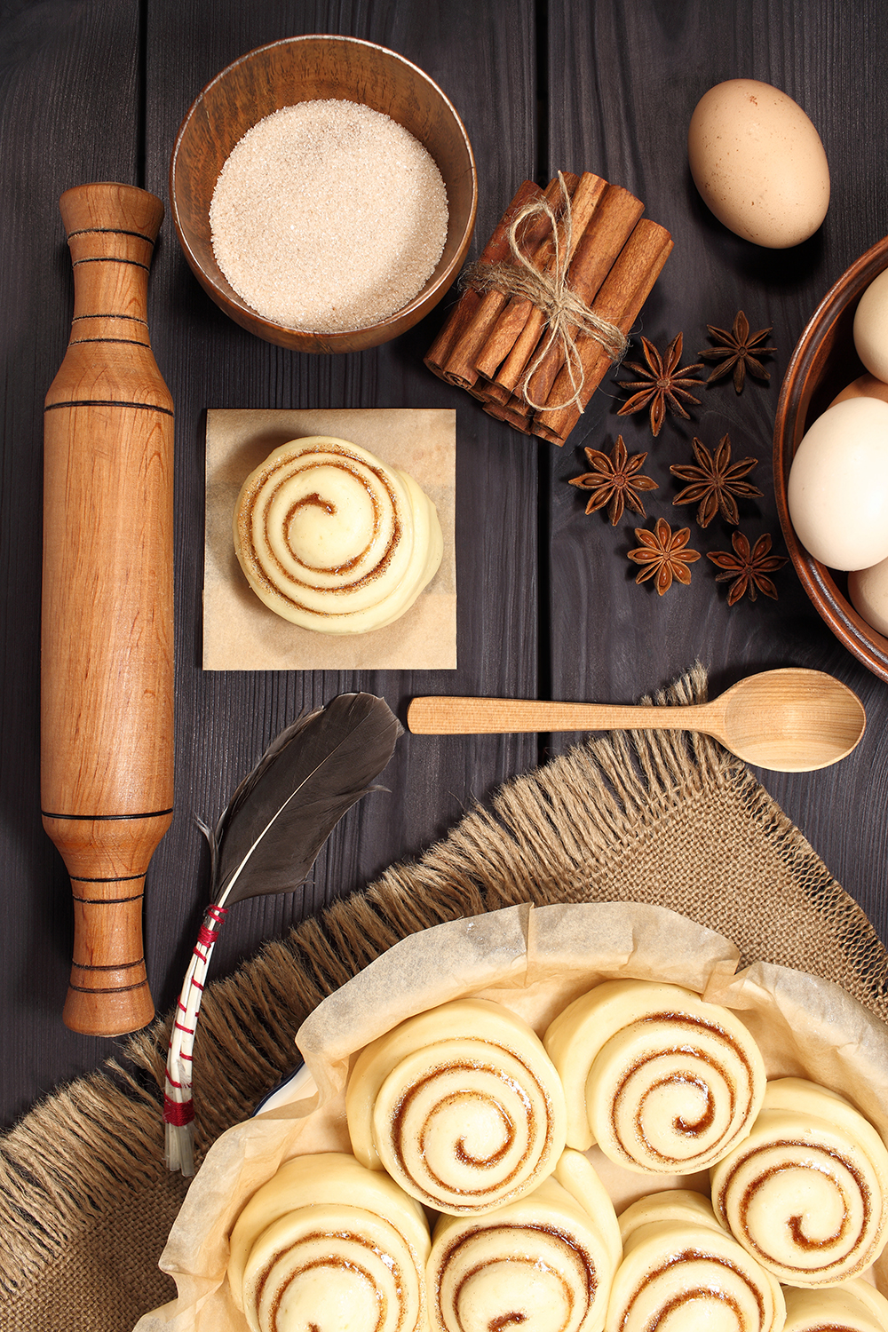 Set of 11 photos - raw buns: cinnamon rolls prepared for baking on a background of rustic table example image 17