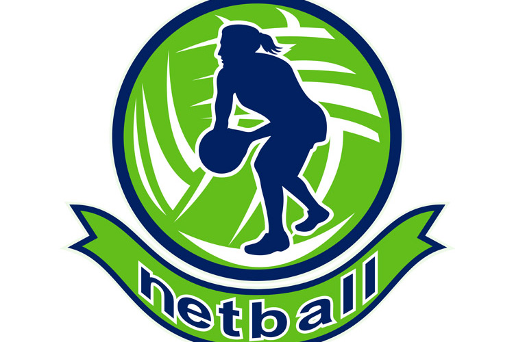 Netball player passing ball example image 1