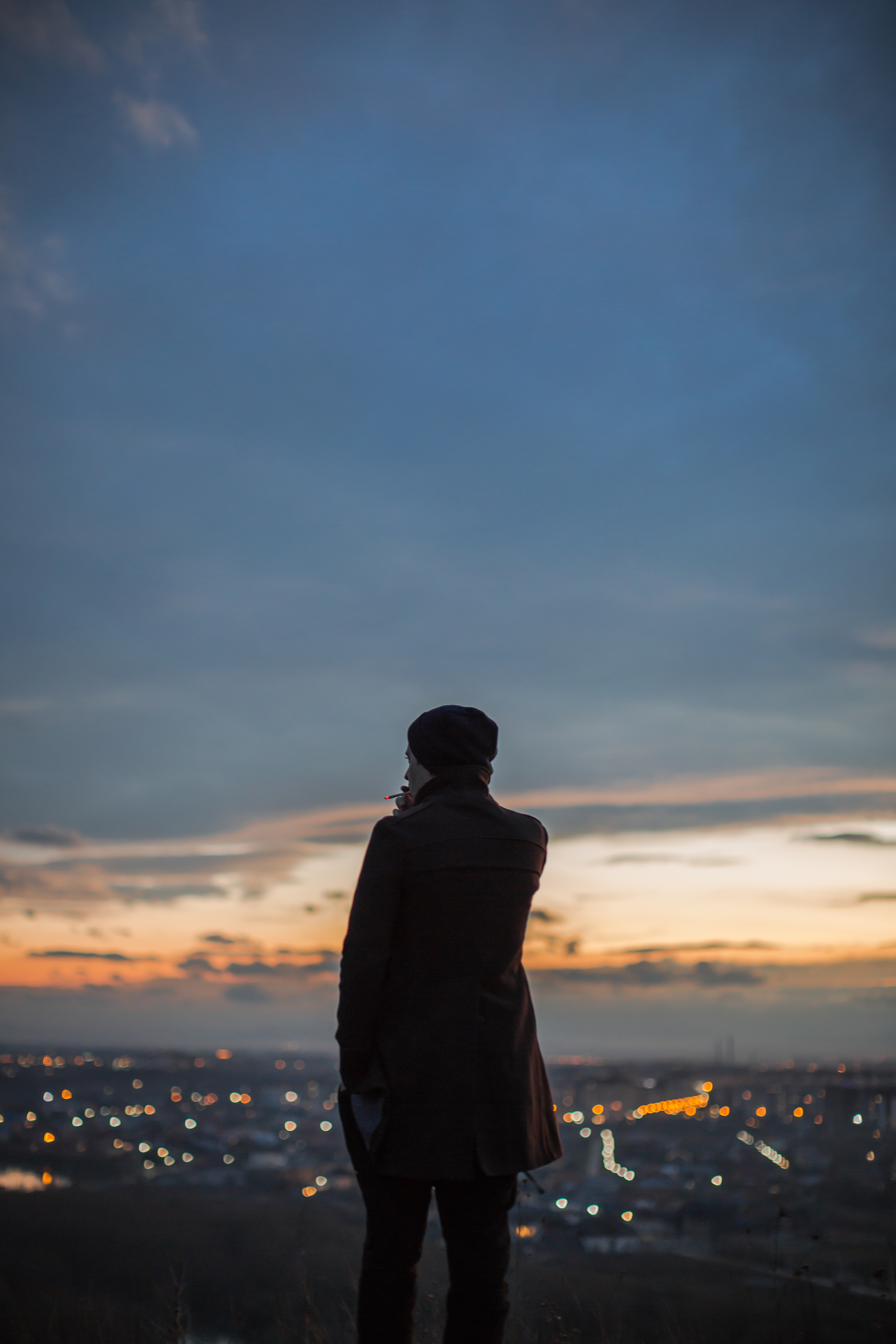 Man watching sunset from the hill example image 1