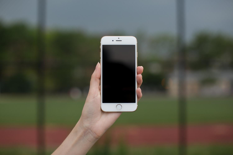 Female hand holding smartphone  example image 1