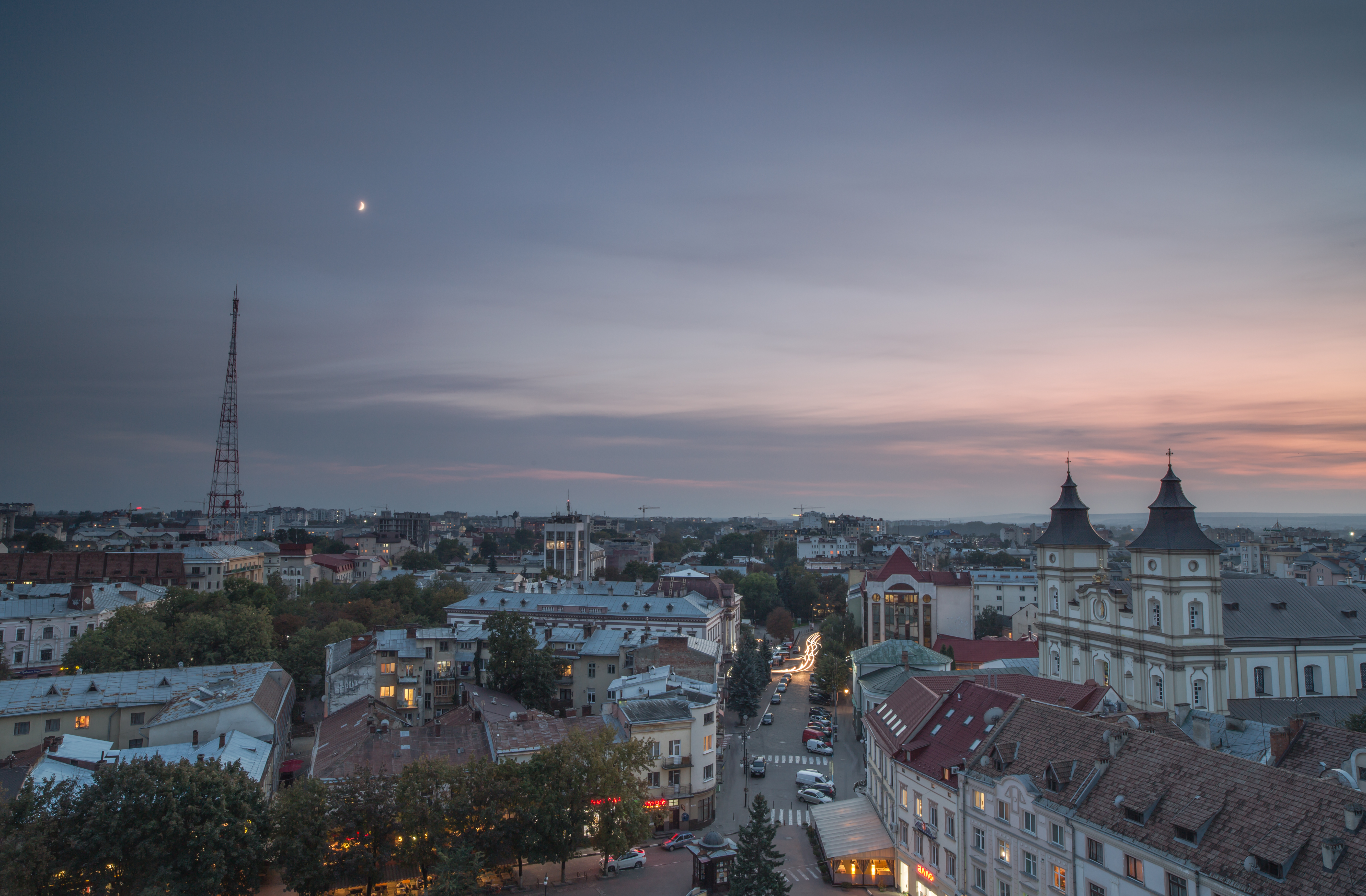 Aerial view of old European city during sunset example image 1