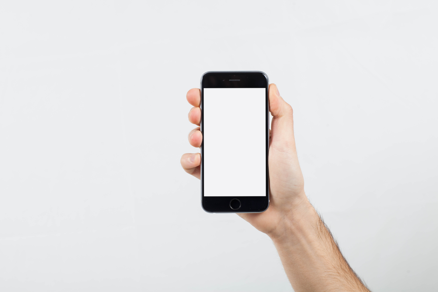Male Hand holding mobile smart phone with blank screen example image 1