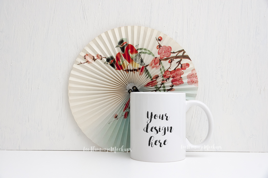 White coffee 11oz mug mock up oriental fan background PSD example image 1