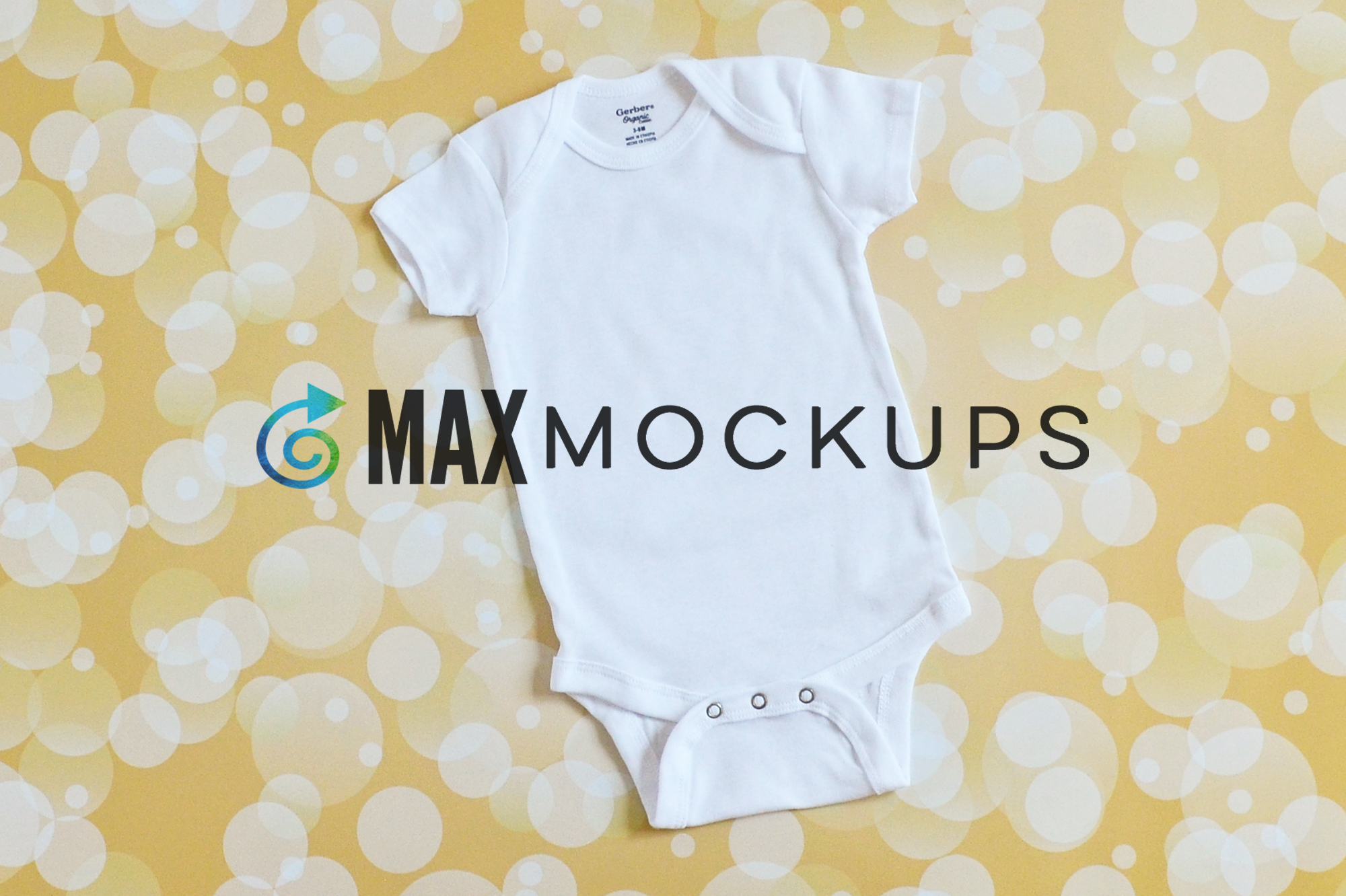 White baby bodysuit mockup, flatlay, with gold backdrop example image 1