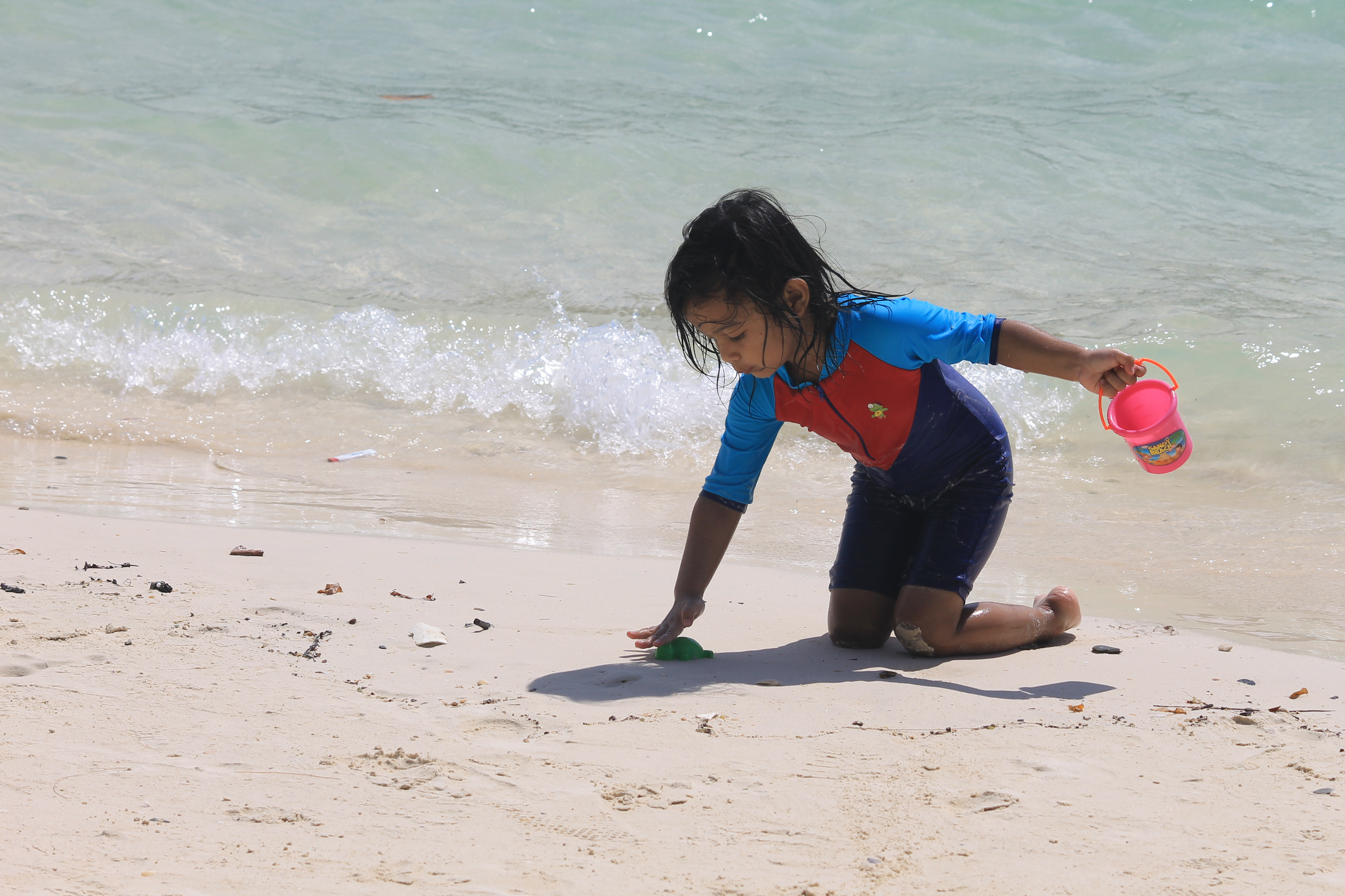 Baby Playing in Beach example image 1