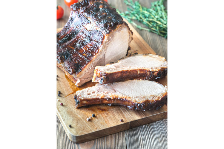 Grilled pork ribs on the wooden board example image 1