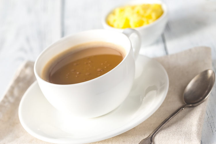 Cup of coffee with ghee butter example image 1