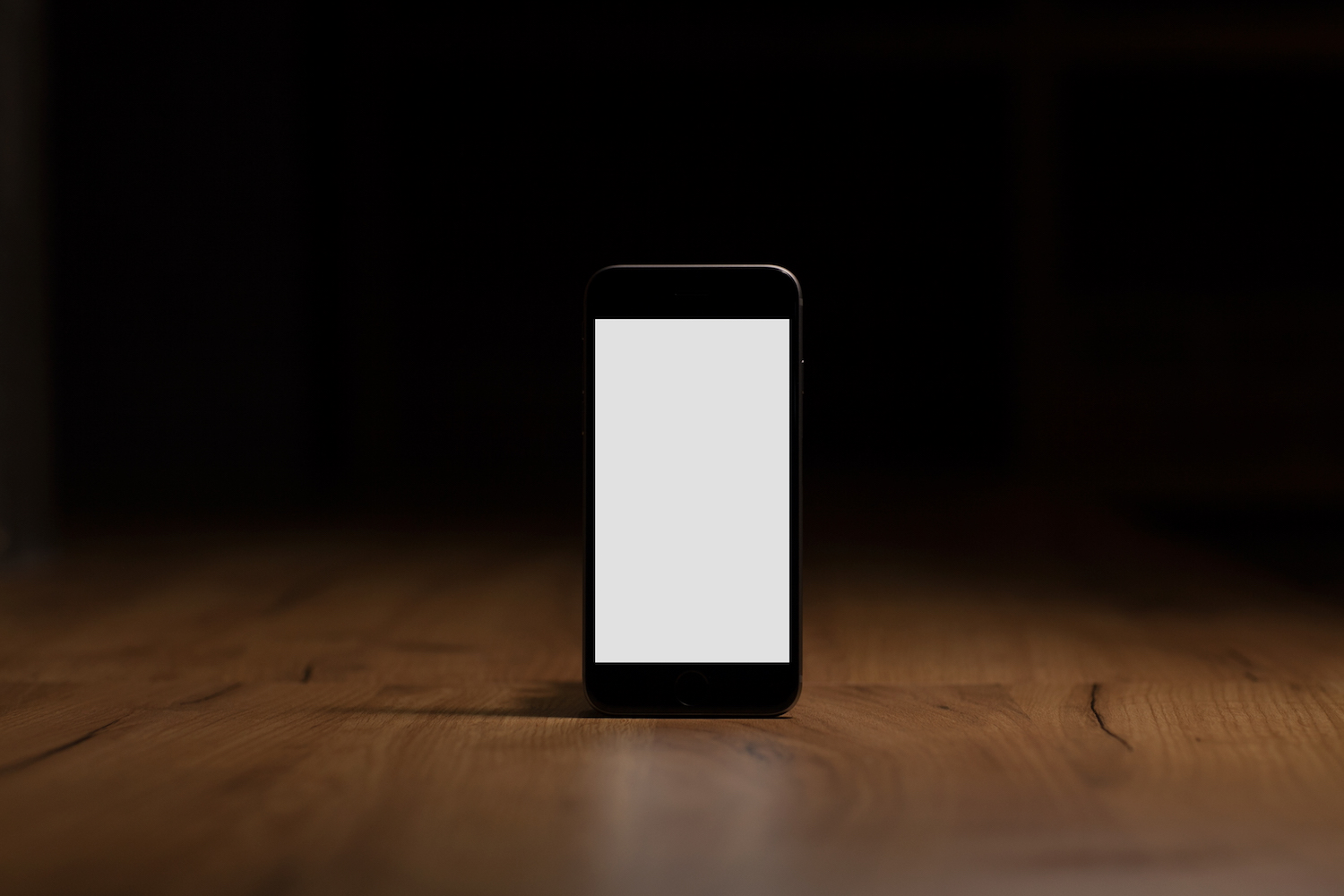 Mobile smart phone with blank screen on the table example image 1