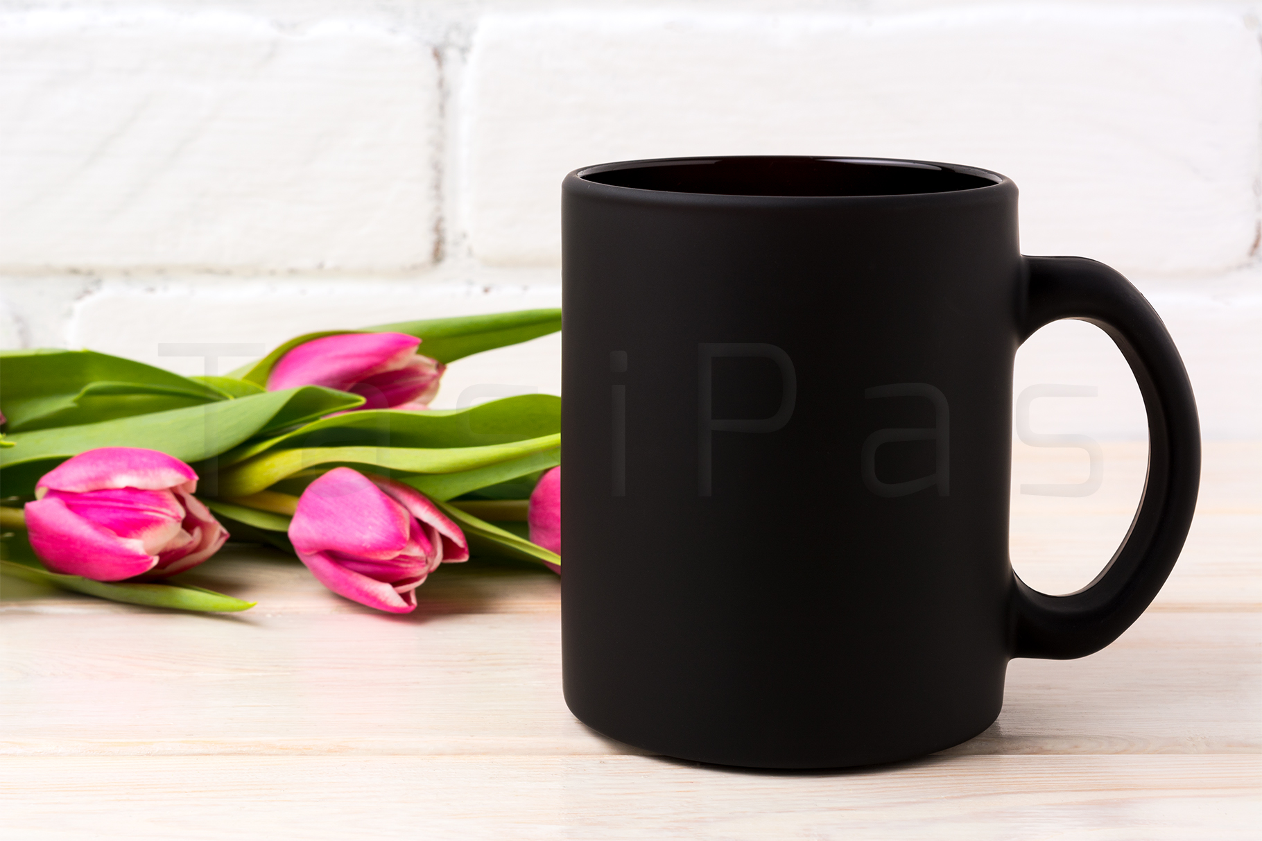 Black coffee mug mockup with rich magenta pink tulips bouquet near painted brick wall. example image 2