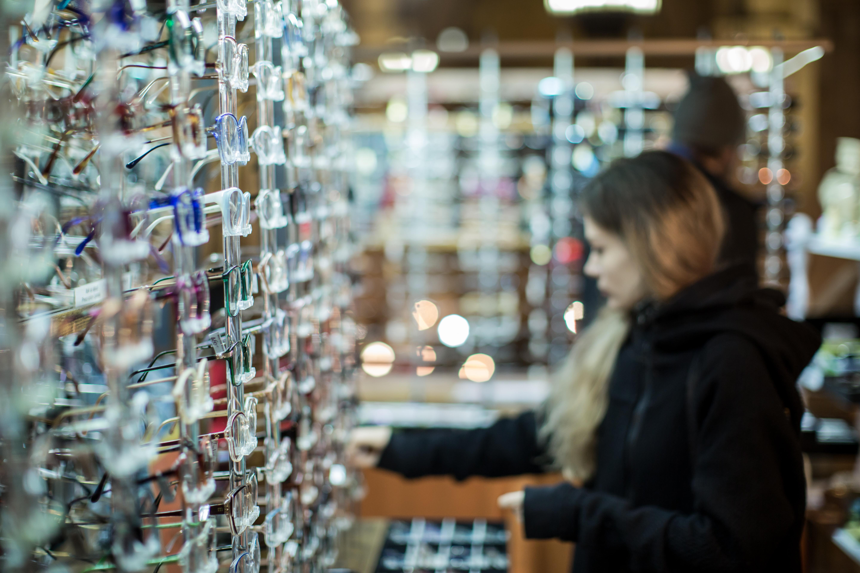 Girl picking glasses frame example image 1