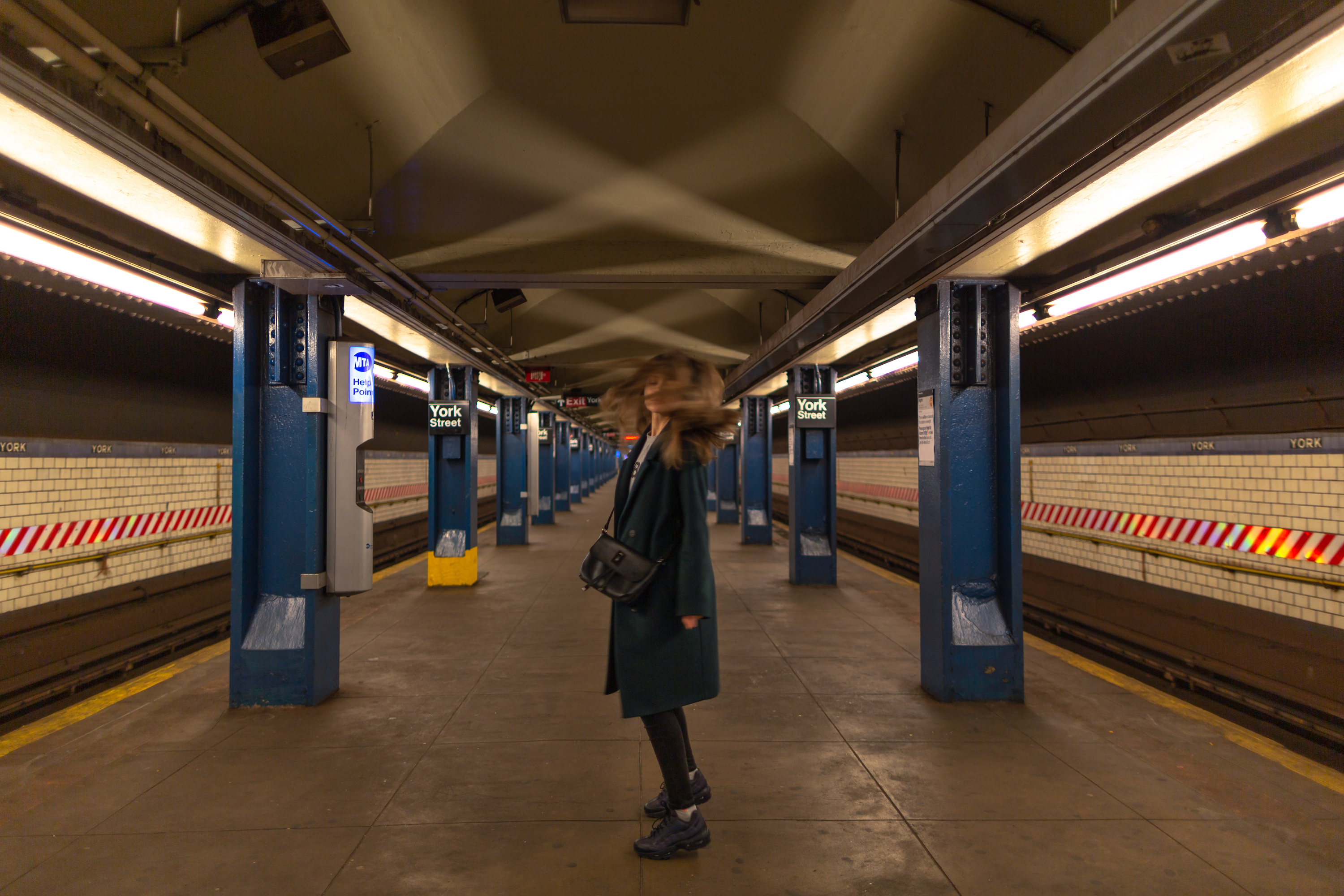 Girl dancing in the subway station example image 1