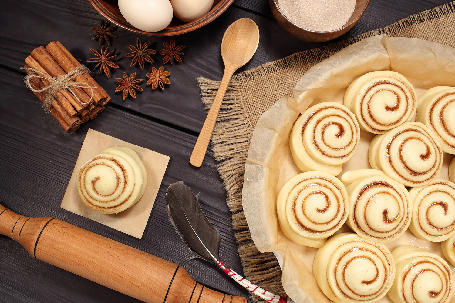 Set of 11 photos - raw buns: cinnamon rolls prepared for baking on a background of rustic table example image 14