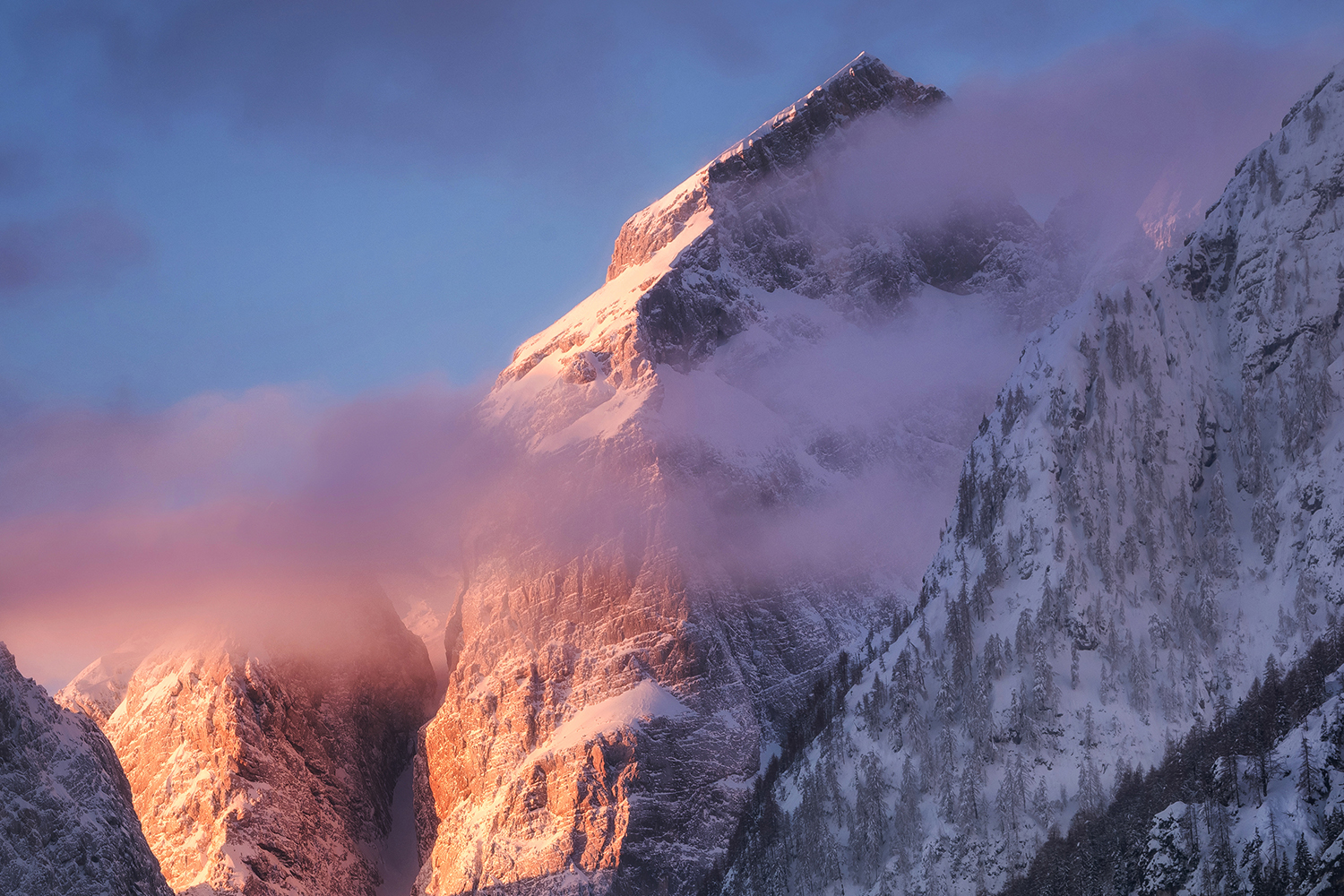 Sunrise in the mountains covered wiht snow example image 1