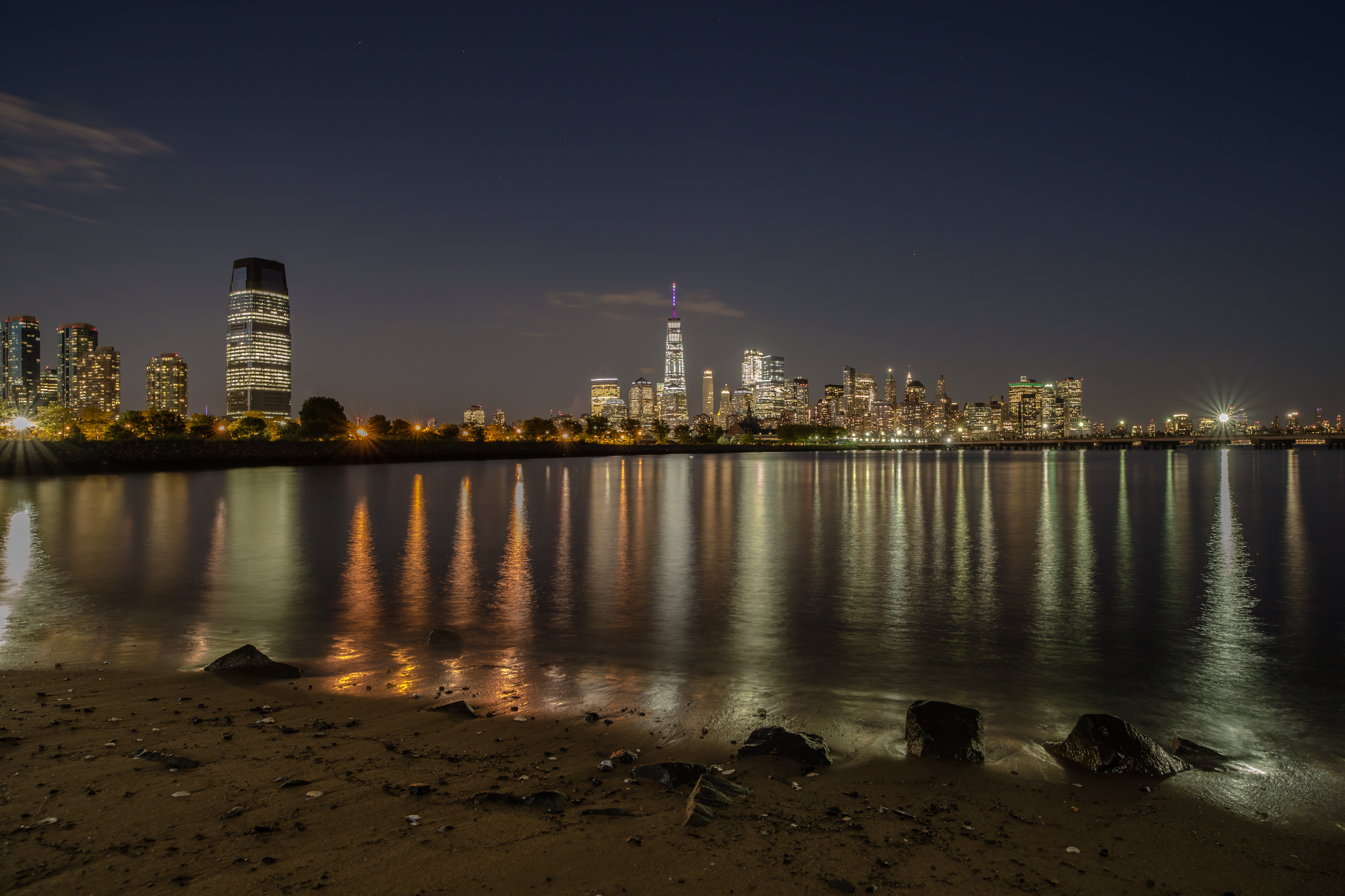 Manhattan and jersey city view during twilight from the sand beach example image 1