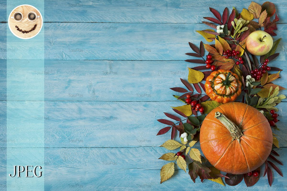 Fall border of apples, berries, pumpkins on blue table, copy example image 1