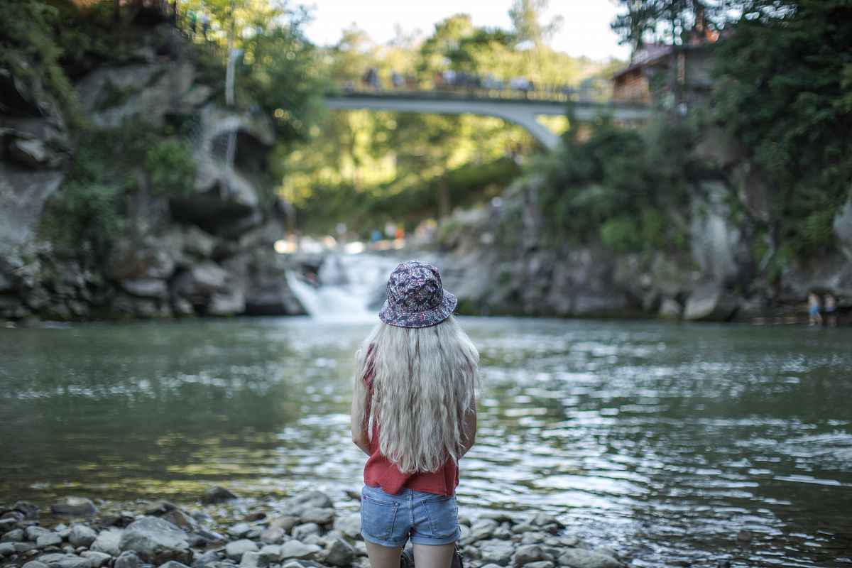 Girl at the waterfall example image 1