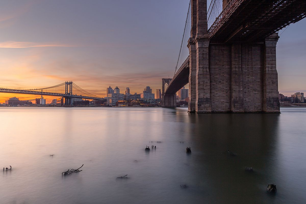 Brooklyn and Manhattan Bridges at sunrise from East River example image 1