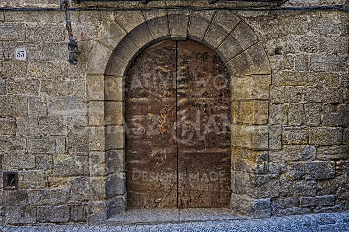 Old Rustic Arched Door In Stone Wall example image 1