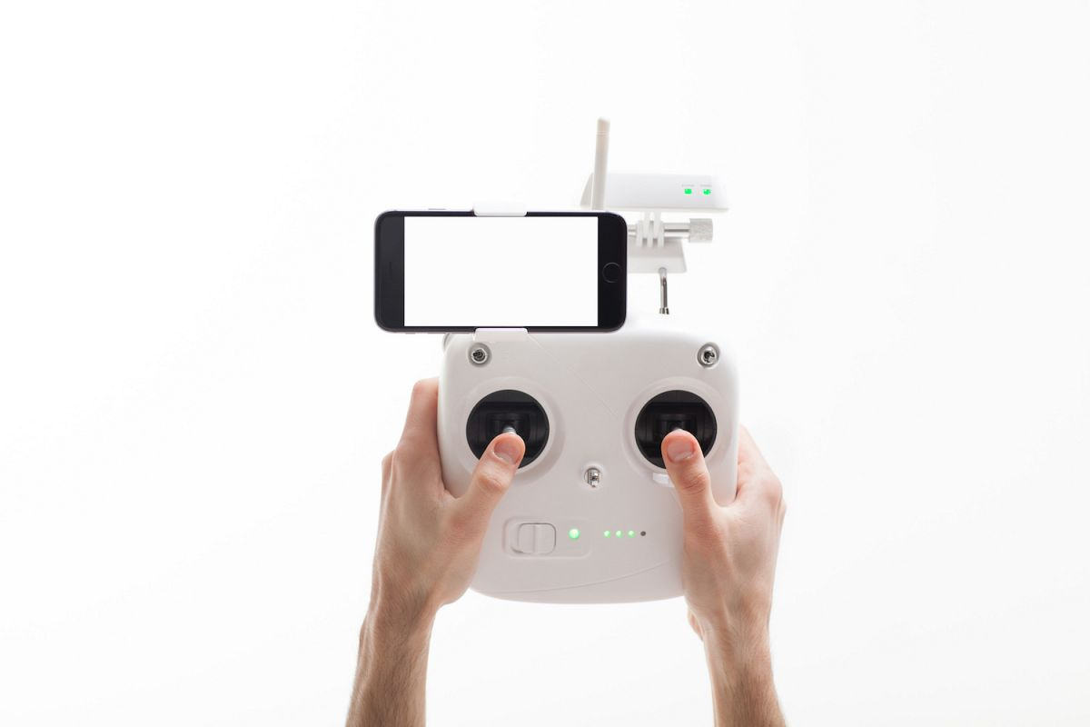 Smartphone with a blank screen on a drone controller example image 1