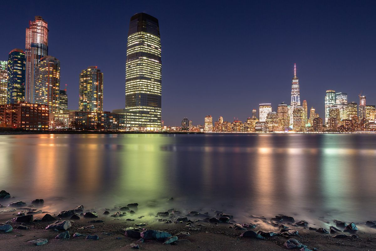 View on Financial district from the beach at night example image 1