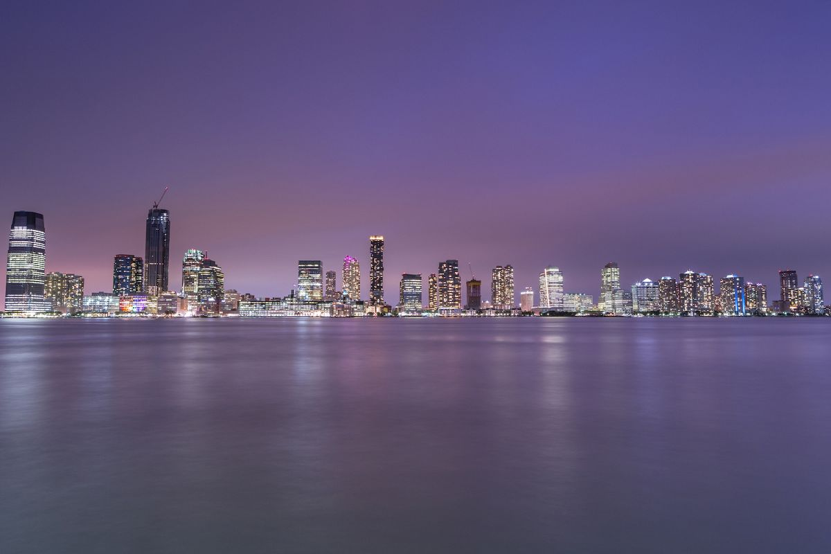 View on Jersey city skyscrapers at night from Hudson river example image 1