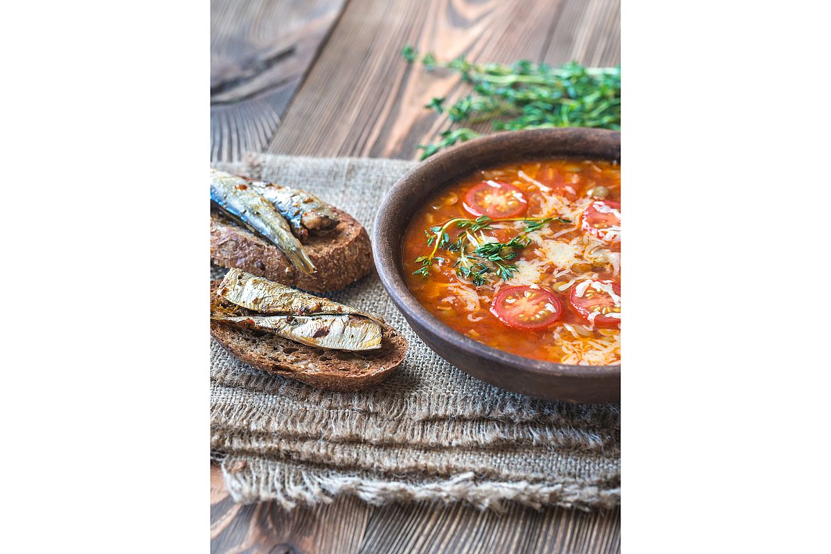 Portion of green lentil tomato soup with toasts example image 1