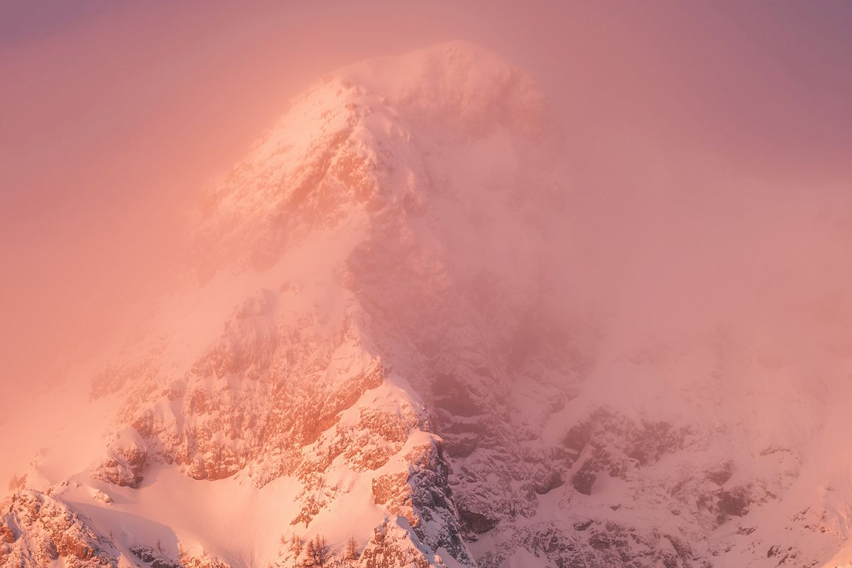 Mountains is pink light with fog example image 1