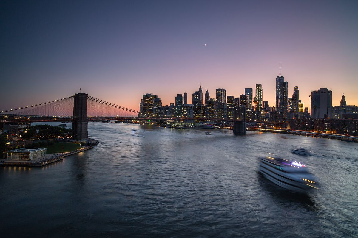 Cruiser crossing East River during sunset	 example image 1