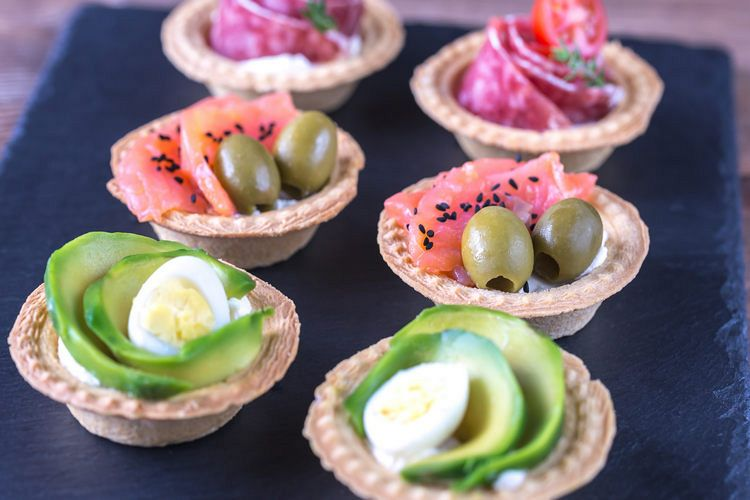 Tartlets with different fillings on the stone board example image 1