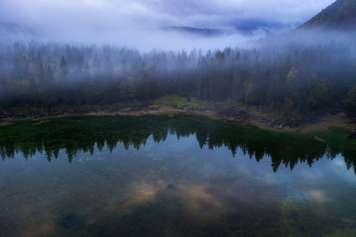 Misty and foggy forest at Fusine Lake example image 1