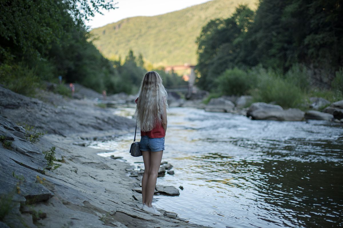 Girl at the river in mountains	 example image 1