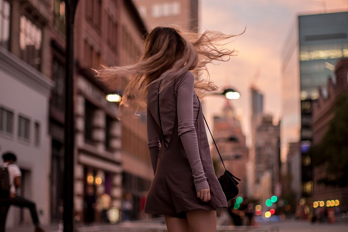 Girl dancing on the street	 example image 1