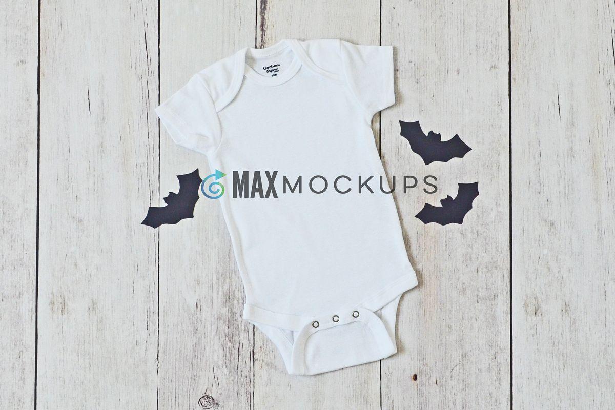 Baby bodysuit Mockup, Halloween bats flatlay stock photo example image 1