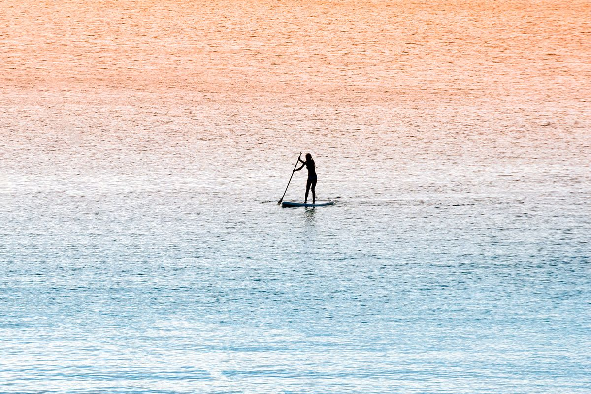 Standup paddle surfer girl example image 1