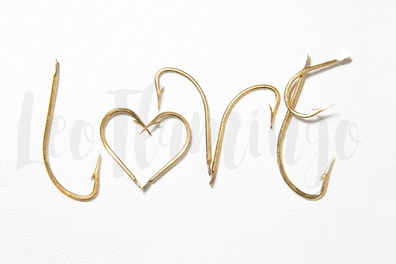 Valentine love concept golden fish hooks stock photo example image 1