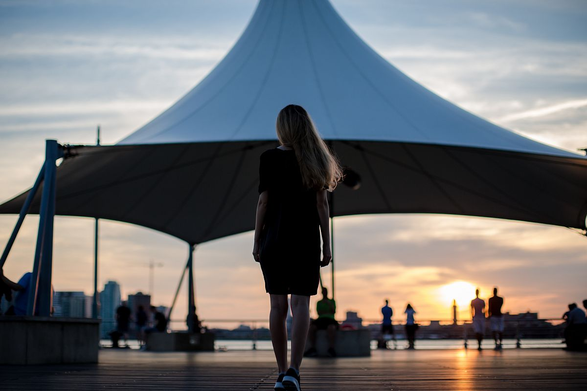 Young girl walking to sunset example image 1