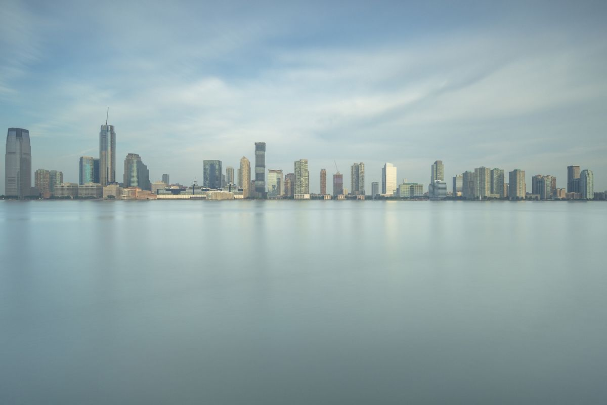 Jersey city coastline from hudson river at sunrise example image 1