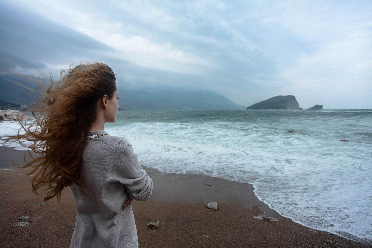 Woman looking into sea example image 1
