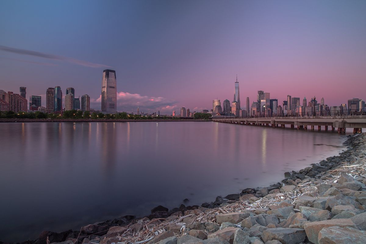 Downtown Manhattan and Jersey city during sunset	 example image 1